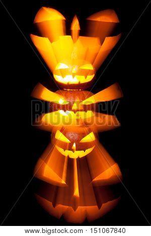 Group of stacked Halloween Jack o Lanterns with black background. Studio shot