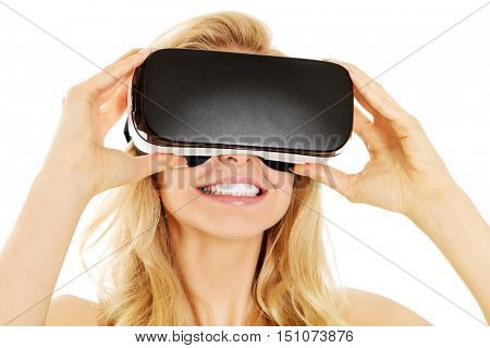 Shocked woman wearing virtual reality goggles