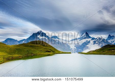 Great view of Mt. Schreckhorn and Wetterhorn above Bachalpsee lake. Dramatic and picturesque scene. Popular tourist attraction. Location Swiss alp, Bernese Oberland, Grindelwald, Europe. Beauty world