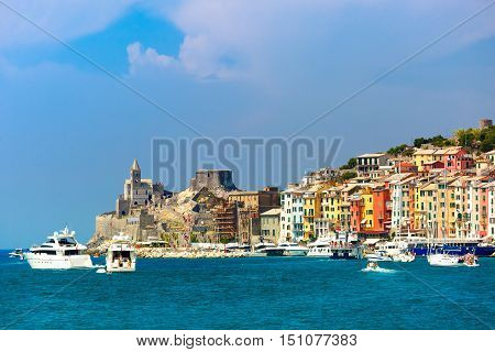 View from sea of colorful picturesque harbour of Porto Venere with Gothic Church of St. Peter, Italian Riviera, Liguria, Italy.