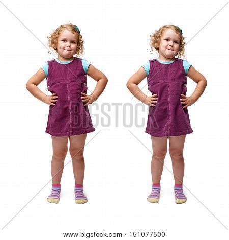 Young bewildered little girl with curly hair and arm on hips in purple dress standing over isolated white background