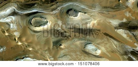 Tribute to Goya, stone ghost in the desert, surreal photograph of the deserts of Africa from the air, stone wavy lines, circles, background yellow stone, sand bottom, abstracto surrealism,