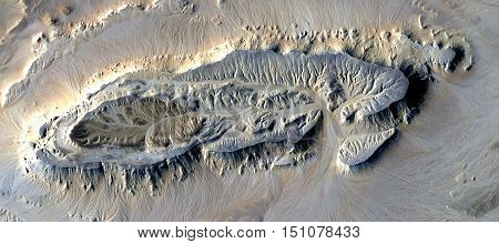 The first human fossil footprint in the desert of Africa as seen from the air, abstract photography,artistic mirage, desert landscapes eroded by water, wind, heat, abstract naturalism,