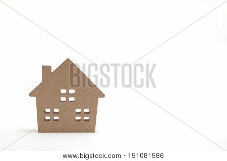 Miniature white house on white background. New house concept.