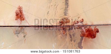 poppies in the desert, abstract photograph of the deserts of Africa from the air, abstract landscape bird's eye view, abstract expressionist composition roads in the desert, artistic composition