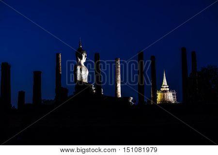 Silhouette Buddha Statue in Wat Mahathat Sukhothai Historical Park ,Sukhothai ,Thailand