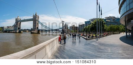 LONDON, UK - 03 JUNE 2016: London Bridge and surrounding land with tourists and visitors