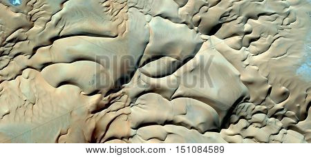soft texture, creamy, pale yellow, polished sand, eager to put the finger,abstract photography deserts of Africa from the air, waves in the desert,landscapes of deserts,imaginary shapes,