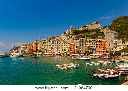 Colorful picturesque harbour of Porto Venere with San Lorenzo church, Doria Castle and Gothic Church of St. Peter, Italian Riviera, Liguria, Italy.