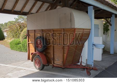 A vintage horse box used as a feeder for horses