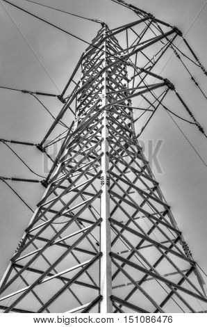 High voltage electrical overhead lines in black and white
