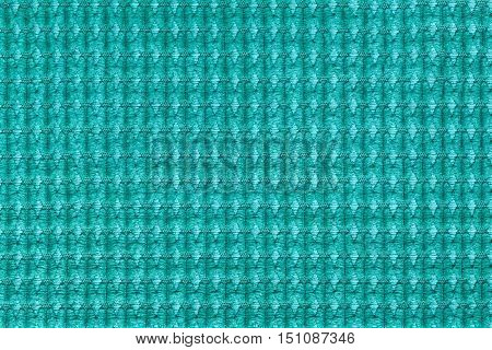 Turquoise background from soft fleecy fabric close up. Texture of textiles macro.