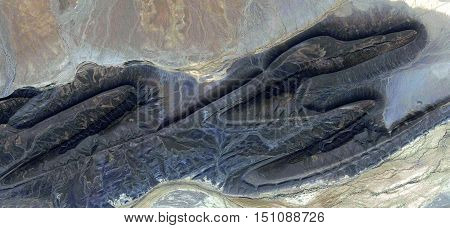 Pterosaur stone giant fossil, flying dinosaur from the air, aerial photography desert africa, texture dark, stone eroded by water, abstract naturalism, dark background, mirage in the desert,