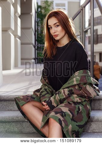 Beautiful fashion girl dressed in military style