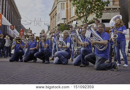 SNEEK, THE NETHERLANDS - OCTOBER 1, 2016: Dweilorkest The Boljeiers performing at the streets of Sneek, during the annual Dweildag.