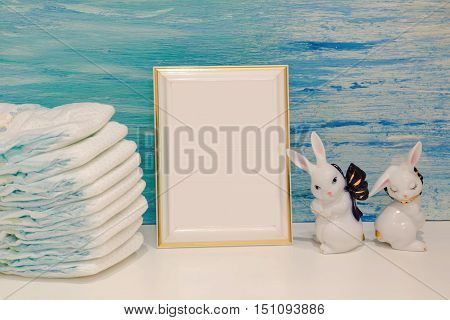 toiletries baby with diapers and pacifiers and pink background