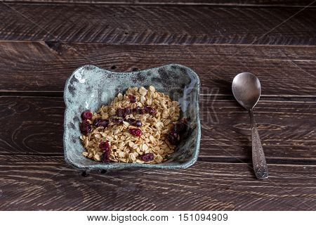 Granola in a clay bowl granola with cranberries healthy breakfast.