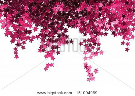 Magenta pink star shaped confetti isolated over white