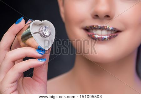 Young woman receiving proposal with diamond ring