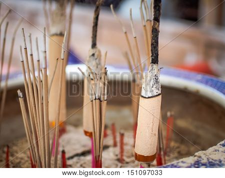 Selective focus on front of josssticks, Incense sticks are burning with smoke use for pay respect to the Buddha