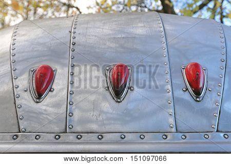 Three Red Lights at Vintage Aluminium Trailer