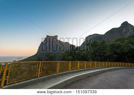 Mountain Road with Pedra da Gavea and Pedra Bonita Rocks in the Horizon in Rio de Janeiro, Brazil.