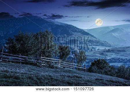 Fence On Hillside Meadow In Mountain At Night