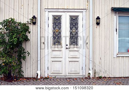 white old street door decorated with ornaments