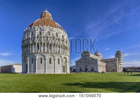 View of the baptistery the cathedral and the leaning tower in square of miracles in Pisa