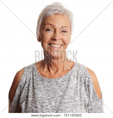 happy senior woman in her sixties with toothy smile
