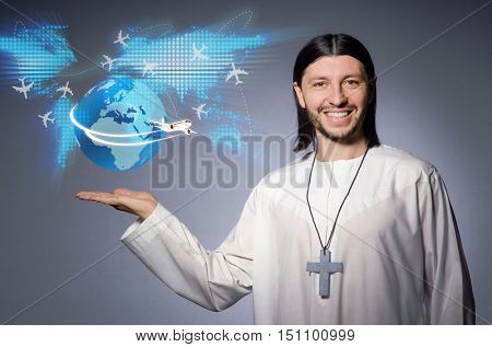 Young christian priest in air travel concept