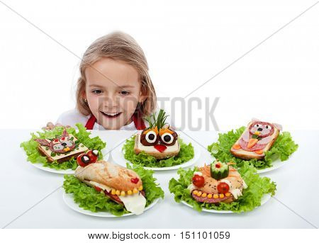 Happy child in awe finding the creative creature sandwiches - isolated with copy space