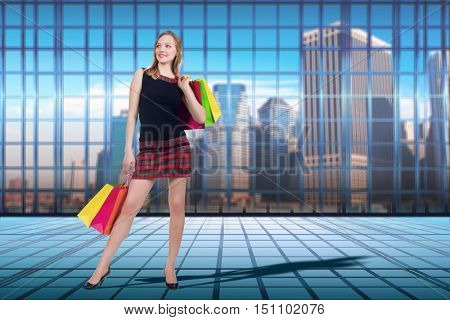 Woman with shopping bags in sale concept