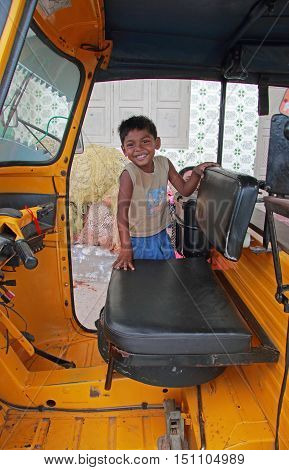 Boy Is Standing In Cab Of Indian Taxi