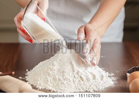 Woman make Cake Mixture on wooden table