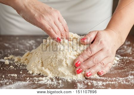 Woman With Lovely Hands Making Home-made Buttermilk Biscuits Using Fresh Ingredients