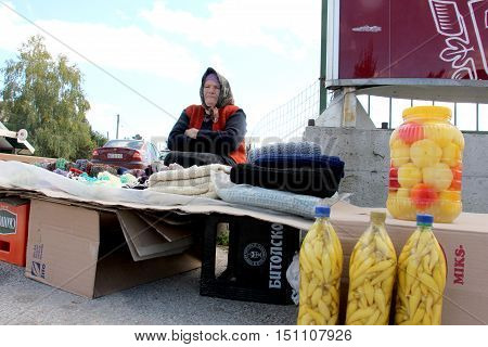 KRAVARI MACEDONIA. 8 OCTOBER 2016- Older women selling hand-made socks and preserved vegetables on the road near the border between Greece and Macedonia near the village Kravari BitolaMacedonia