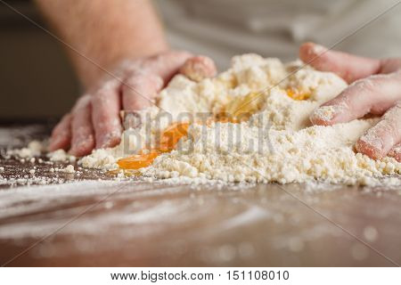 Woman Who Kneads The Homemade Pasta To Prepare Lasagna And Tagliatelle. Italian Cooking