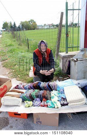KRAVARI MACEDONIA. 8 OCTOBER 2016- Older women selling hand-made socks on the road near the border between Greece and Macedonia near the village Kravari BitolaMacedonia