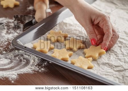Homemade Baking, Kitchen Scene Showing  Woman Holding Baking Tray With Cut Shortbread Biscuits On Ba