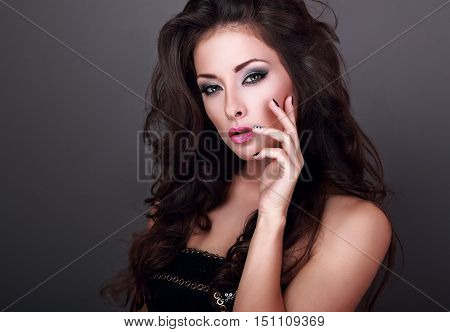 Beautiful Fashionable Makeup Woman With Long Curly Volume Hair And Creative Manicured Nails On Grey