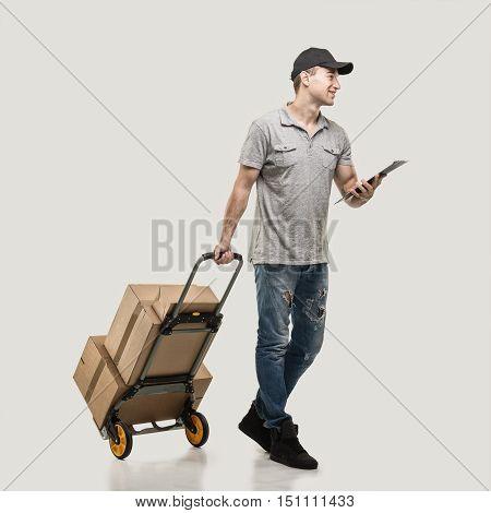 Courier handcart pull boxes and packages on beige