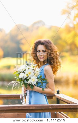 Beautiful Young Bridesmaid With Long Curly Hair