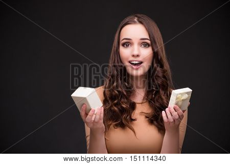 Young woman with giftbox and marriage proposal