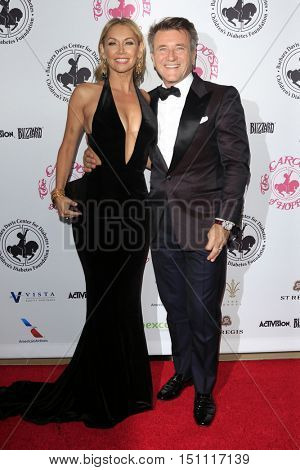 LOS ANGELES - OCT 8:  Kym Herjavec Johnson, Robert Herjavec at the 2016 Carousel Of Hope Ball at the Beverly Hilton Hotel on October 8, 2016 in Beverly Hills, CA