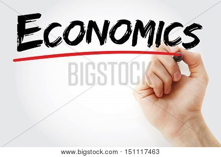 Hand Writing Economics With Marker