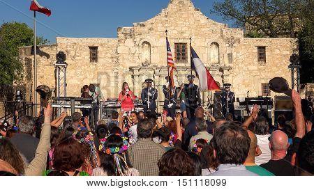 SAN ANTONIO, TEXAS - APRIL 14: A crowd gathers in front of the Alamo for the annual Fiesta San Antonio celebration in downtown San Antonio, Texas on April 14th, 2016.