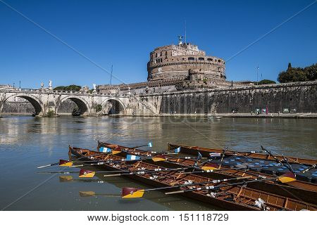 View of Castel Sant'Angelo and the canoes in the foreground from the Tiber in Rome Italy