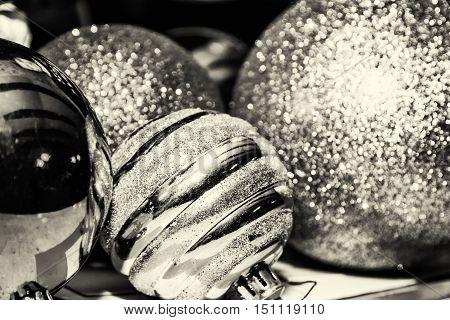 Shimmering christmas baubles. Symbolic objects. Xmas decoration. Black and white photo.