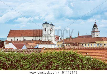 Jesuit church and Parish church of saint archangel Michael in Skalica Slovak republic. Place of worship. Cultural heritage. Retro photo filter. Travel destination.